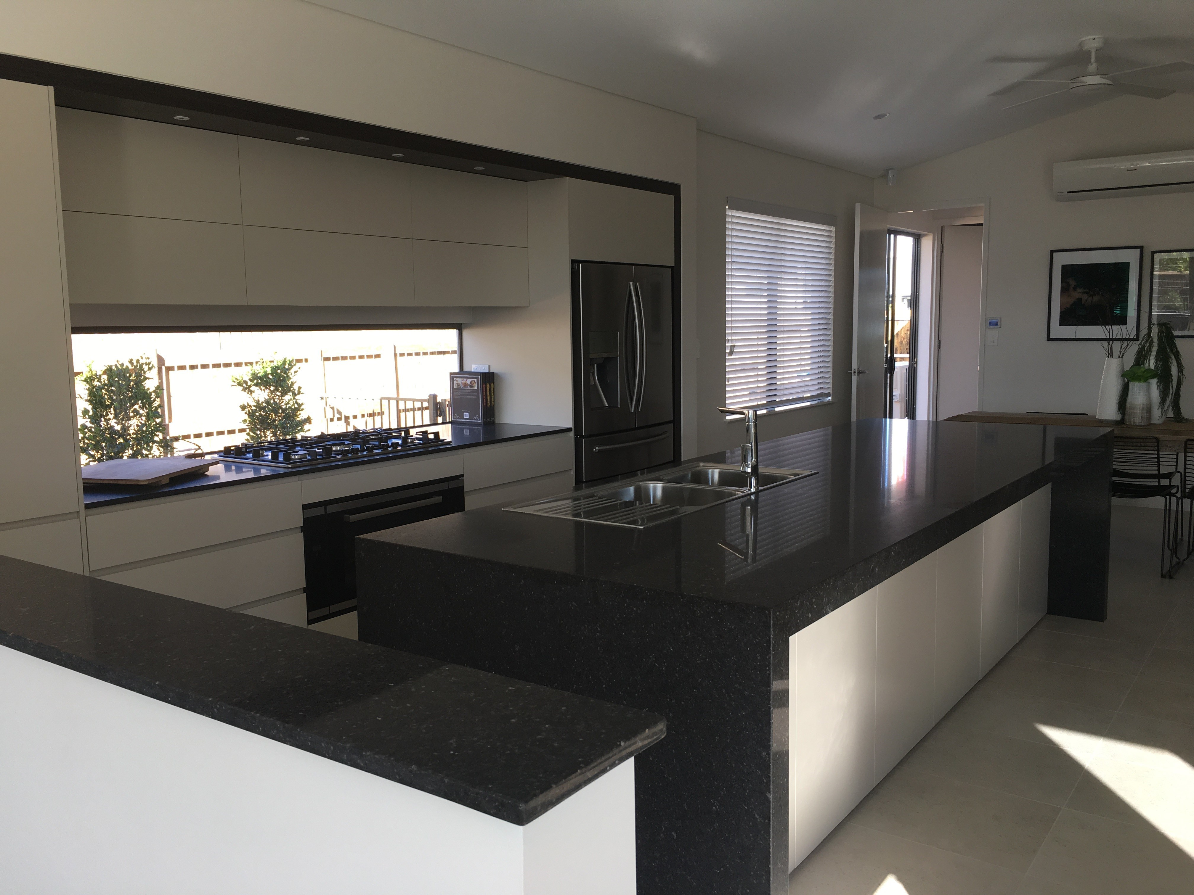 Kitchen tops to display home for Couger Homes